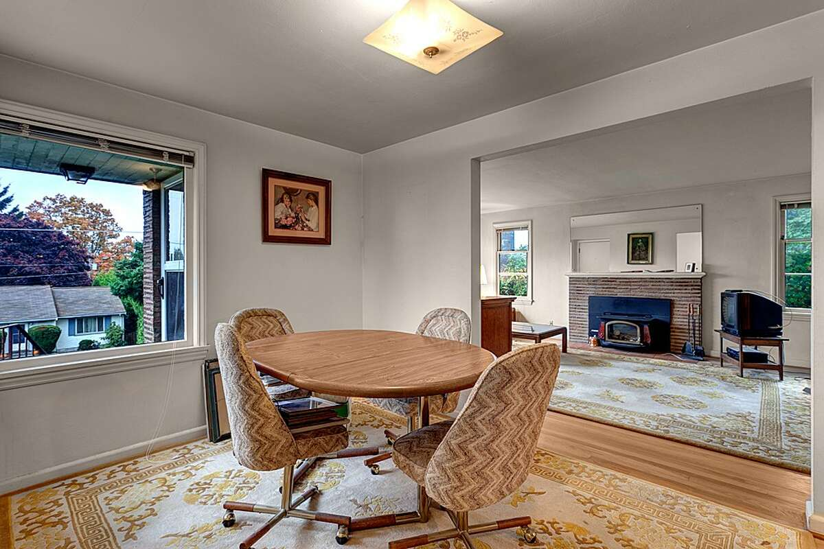 Dining room of 11032 Palatine Ave. N. The 2,570-square-foot brick house, built in 1949, has four bedrooms, two bathrooms, a finished basement with a fireplace and a 7,560-square-foot lot with a bick back yard. It's listed for $399,000.