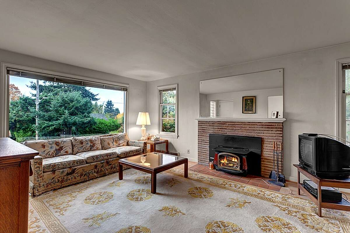 Living room of 11032 Palatine Ave. N. The 2,570-square-foot brick house, built in 1949, has four bedrooms, two bathrooms, a finished basement with a fireplace and a 7,560-square-foot lot with a bick back yard. It's listed for $399,000.