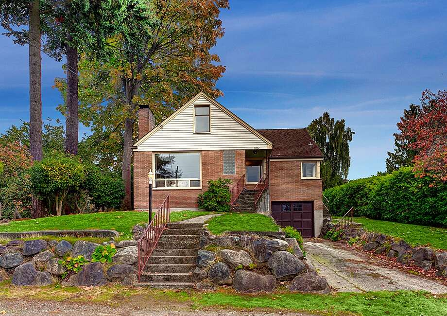 Broadview offers a little more elbow room and affordability than such closer-in Northwest Seattle neighborhoods as Sunset Hill and Loyal Heights, while still providing convenient access to Puget Sound, the Ballard center and downtown. Here are three homes there for less than $400,000, starting with this brick house at 11032 Palatine Ave. N. The 2,570-square-foot house, built in 1949, has four bedrooms, two bathrooms, a finished basement with a fireplace and a 7,560-square-foot lot with a bick back yard. It's listed for $399,000. Photo: James Redmond/Redfin Corp.