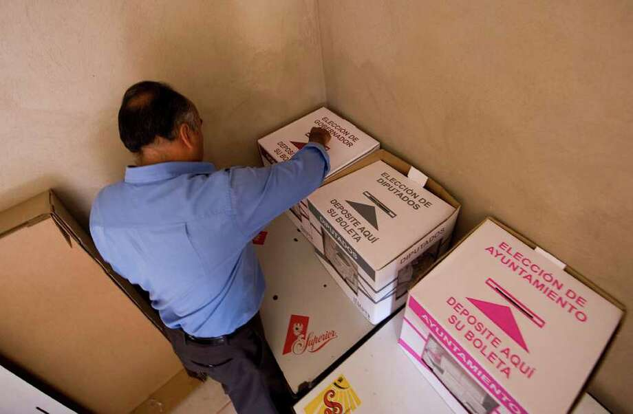 A man casts his vote during Michoacan' state local election, in Numaran Municipality, Michoacan State, Mexico, on November 13, 2011. AFP PHOTO/Alfredo ESTRELLA (Photo credit should read ALFREDO ESTRELLA/AFP/Getty Images) Photo: ALFREDO ESTRELLA / AFP