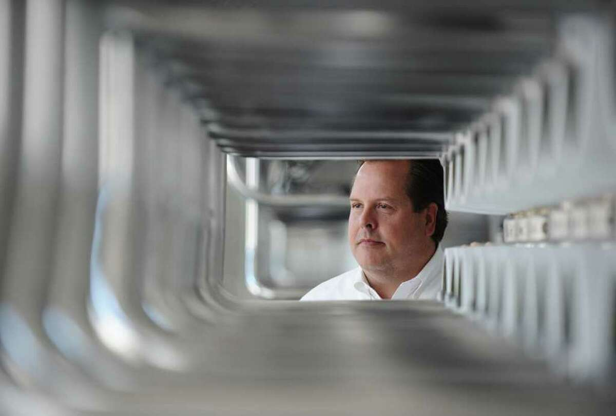 DAN DALSTRA : FOR THE CHRONICLE xxxx: John Balliew, Vice-President of Operations and Technical Services for the El Paso Water Utilities Public Service Board, is seen through the pipes of the Kay Bailey Hutchison Desalination plant in El Paso, TX., Tuesday September 5th. The plant is the largest inland desalination plant in the country and cleans brackish groundwater by removing much of the salt from the water.