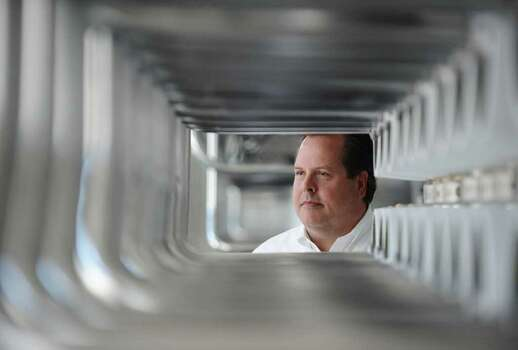 John Balliew, Vice-President of Operations and Technical Services for the El Paso Water Utilities Public Service Board, is seen through the pipes of the Kay Bailey Hutchison Desalination plant in El Paso, TX., Tuesday September 5th. The plant is the largest inland desalination plant in the country and cleans brackish groundwater by removing much of the salt from the water. Photo: DAN DALSTRA, Chronicle / Houston Chronicle