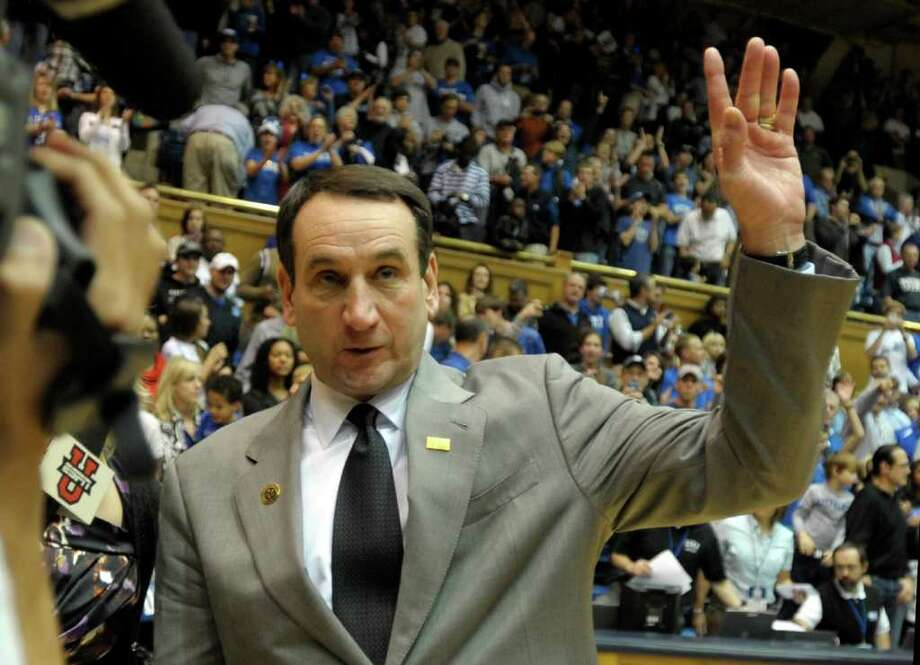 DURHAM, NC - NOVEMBER 12:   Duke Blue Devils head coach Mike Krzyzewski acknowledges his fans after his 902nd win against Presbyterian Blue Hose at an NCAA game in Cameron Indoor Stadium on November 12, 2011 in Durham, North Carolina. Coach Mike Krzyzewski tied Bobby Knight for the most wins in NCAA Division I basketball.  (Photo by Sara D. Davis/Getty Images) Photo: Sara D. Davis / 2011 Getty Images
