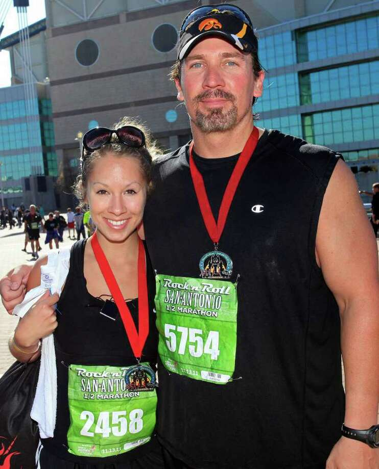 FEATURES; ACS RNR MARATHON JMS; 11/13/11; From the left, Andrea Timmons and Mike O'Connor after finishing the Rock 'n' Roll Marathon, Sunday, November 13, 2011, at The Alamodome in San Antonio. ( Photo by J. Michael Short / SPECIAL ) Photo: J. MICHAEL SHORT, SPECIAL TO THE EXPRESS-NEWS / THE SAN ANTONIO EXPRESS-NEWS