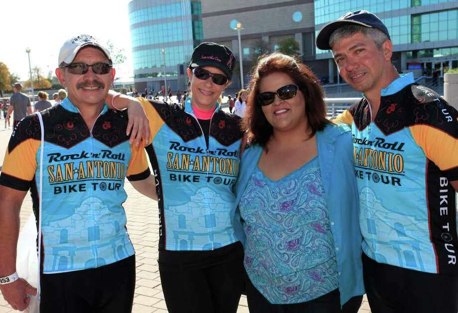 FEATURES; ACS RNR MARATHON JMS; 11/13/11; From the left, Steve and Janet Flores, Cindy and Tom Lynds after finishing the Rock 'n' Roll Marathon, Sunday, November 13, 2011, at The Alamodome in San Antonio. ( Photo by J. Michael Short / SPECIAL ) Photo: J. MICHAEL SHORT, SPECIAL TO THE EXPRESS-NEWS / THE SAN ANTONIO EXPRESS-NEWS