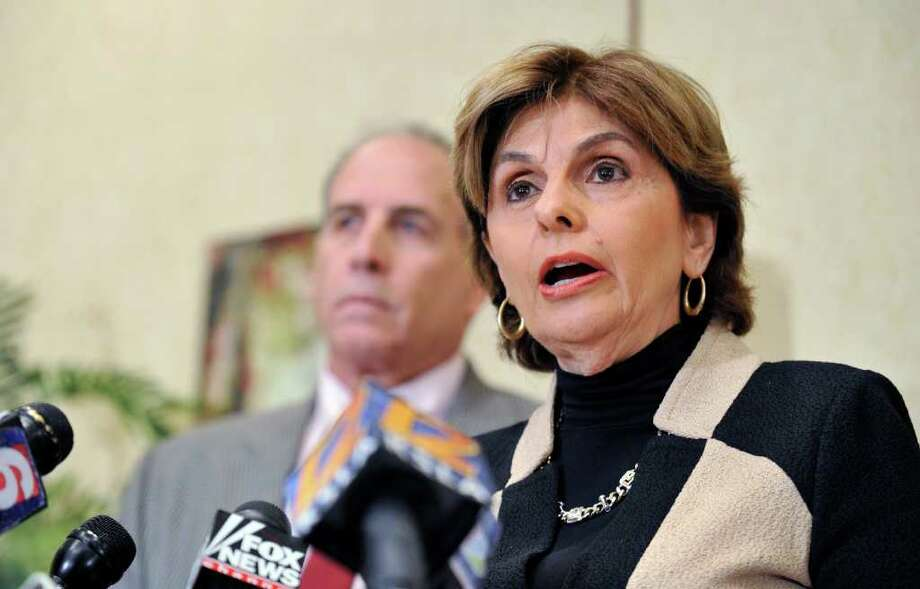 Attorney Gloria Allred introduces Victor Jay Zuckerman, left, the former boyfriend of Allred's client, Sharon Bialek, during a news conference in Shreveport, La., Monday, Nov. 14, 2011. Zuckerman said Monday that he and Bialek met Herman Cain in the late 1990s, directly contradicting Cain's assertions that he had never met Bialek, who has accused the Republican presidential contender of inappropriate sexual behavior. (AP Photo/Kita Wright) Photo: Kita Wright / FR156206 AP