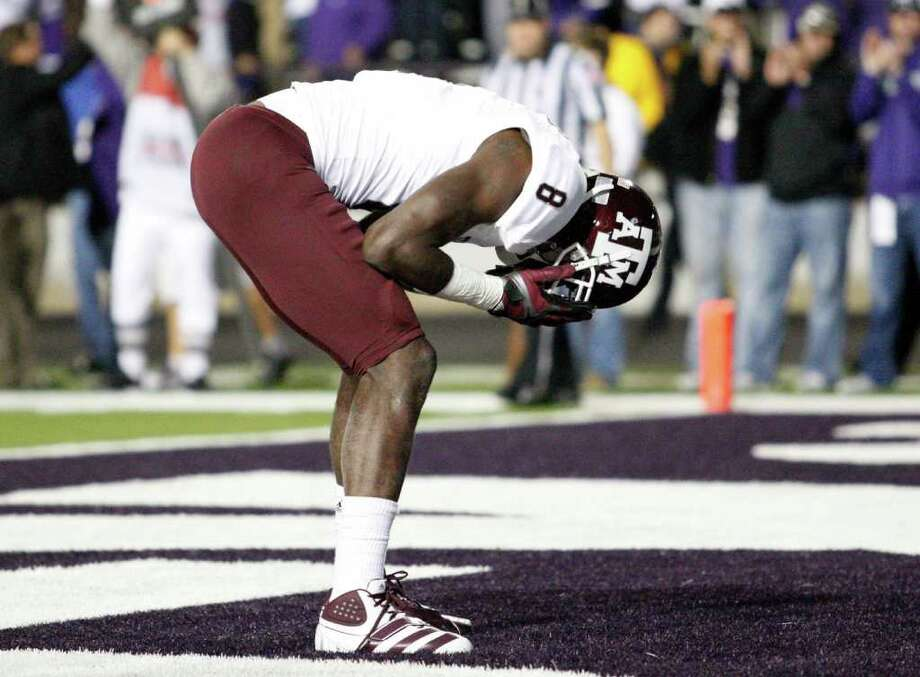 Texas A&M wide receiver Jeff Fuller (8) reacts after missing a pass from quarterback Ryan Tannehill pass during a two-point conversion attempt in the third overtime against Kansas State on Saturday, November 12, 2011, at Bill Snyder Family Stadium in Manhattan, Kansas. K-State won, 53-50, in four overtime periods. Photo: Bo Rader, MCT / Wichita Eagle