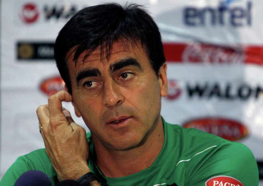 Bolivia's coach Gustavo Quinteros speaks during a press conference before a training session in San Cristobal, Venezuela, Monday, Nov. 14, 2011. Bolivia will face Venezuela during a 2014 World Cup qualifying soccer match Tuesday. (AP Photo/Ariana Cubillos) Photo: Ariana Cubillos