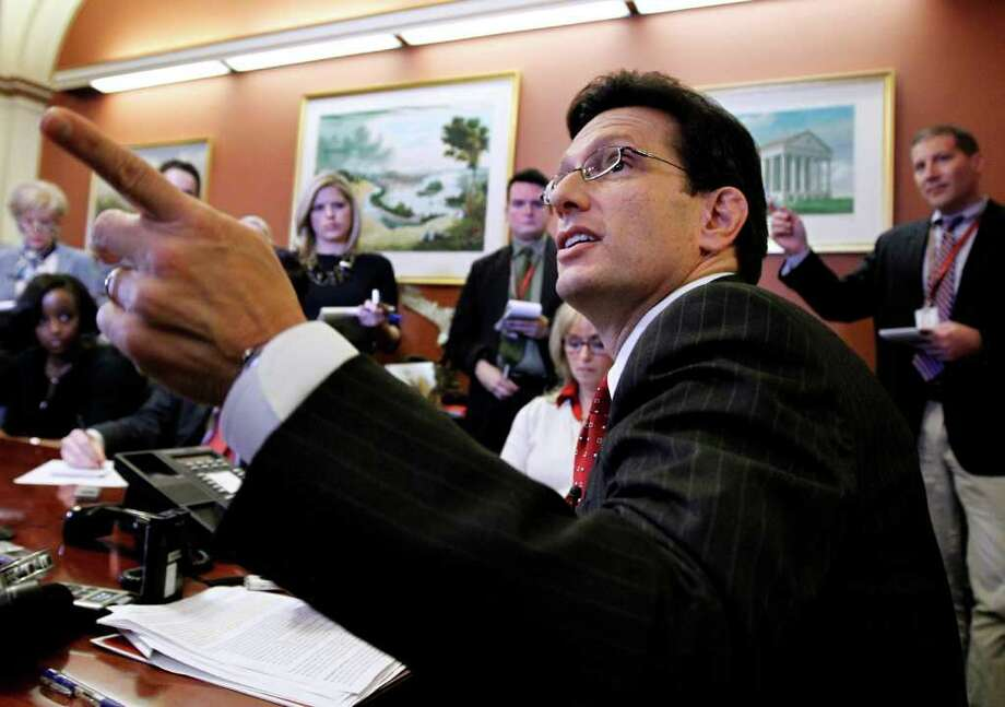 House Majority Leader Eric Cantor of Va. gestures during a news briefing on Capitol Hill in Washington, Monday, Nov. 14, 2011.  (AP Photo/Manuel Balce Ceneta) Photo: Manuel Balce Ceneta
