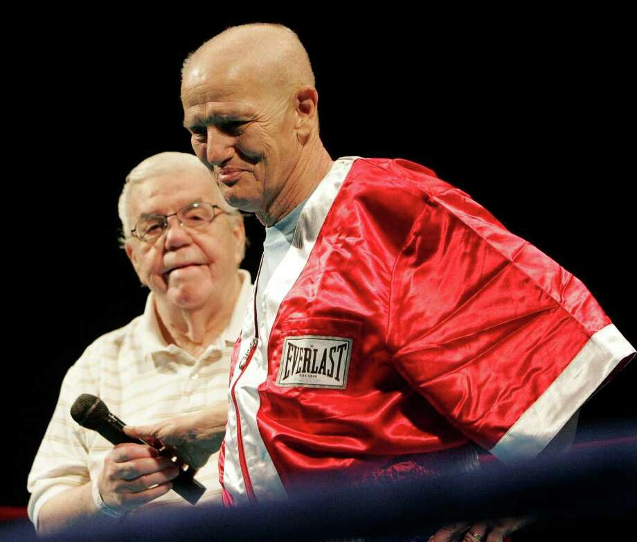 "Lou Duva, left, made a special presentation to Joe Souza, right, the ""Greatest Cut Guy in the World"" at ""Lou Duva's Hall of Fame Fight Night at the Municipal"" Friday night  at Municipal Auditorium, May 30, 2008. Photo: J. MICHAEL SHORT, SPECIAL TO THE EXPRESS-NEWS / THE SAN ANTONIO EXPRESS-NEWS"