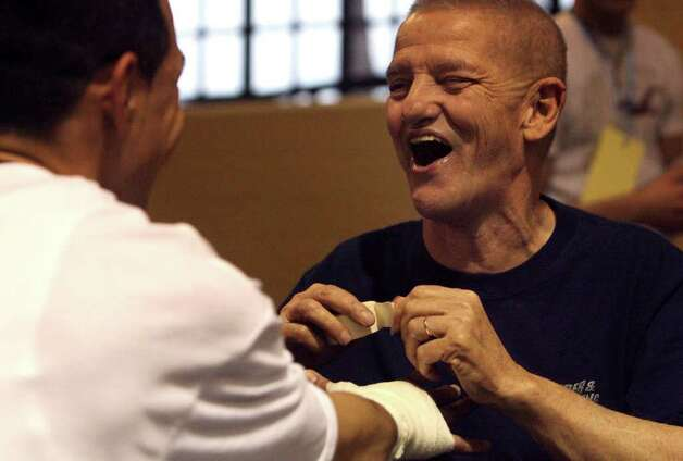 Joe Souza, 73, is a well known fixture in the San Antonio boxing scene and has been helping youth interested in boxing for years. JOHN DAVENPORT / STAFF Photo: JOHN DAVENPORT, SAN ANTONIO EXPRESS-NEWS / SAN ANTONIO EXPRESS-NEWS