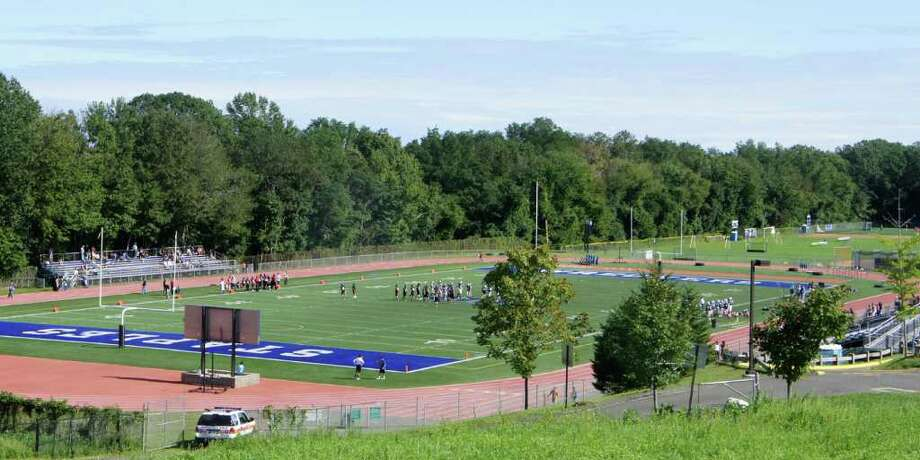 Permanent lighting could be installed in 2012 at the Staples High School football field, after the town settled last week a lawsuit that had contested the plan. Photo: Paul Schott / Westport News