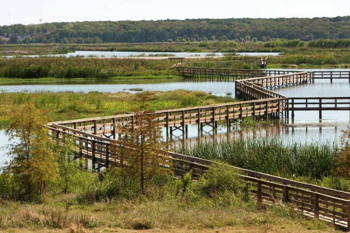 BRETT COOMER PHOTOS : CHRONICLE FILTRATION: A boardwalk zig zags over the water at the John Bunker Sands Wetland Center, located on a cattle ranch, Wetlands remove chemicals better than a waste treatment facility.