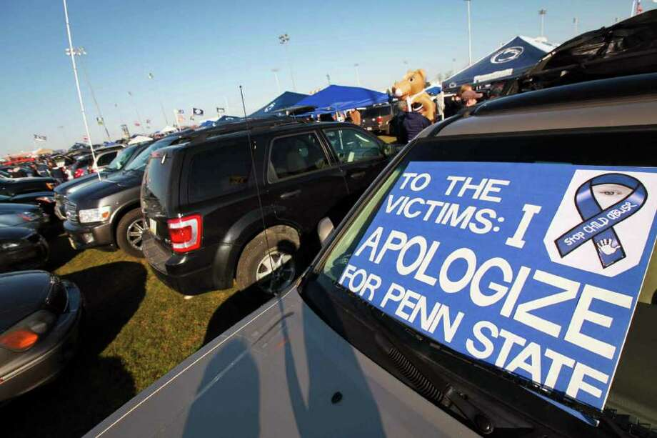 A sign is posted on a car outside Beaver Stadium before an NCAA college football game between Penn State and Nebraska Saturday, Nov. 12, 2011 in State College, Pa. Penn State is playing for the first time in decades without former head coach Joe Paterno, after he was fired in the wake of a child sex abuse scandal involving a former assistant coach. (AP Photo/The Wilmington News-Journal, Suchat Pederson) Photo: Suchat Pederson / The News Journal-2011