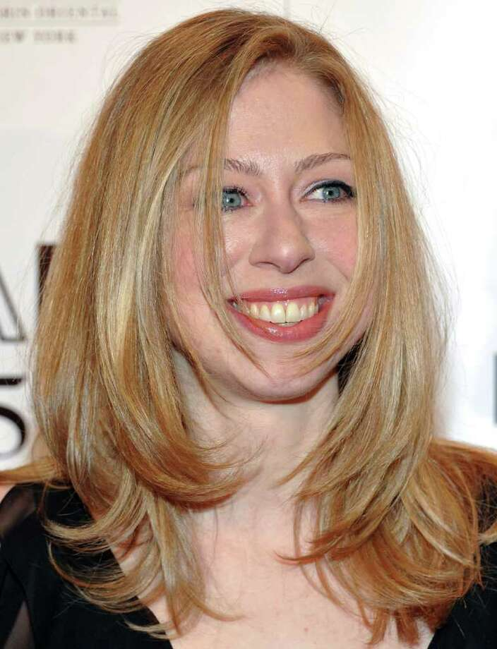 """In this Feb. 9, 2011 photo, Chelsea Clinton attends amfAR's annual New York Gala at Cipriani Wall Street in New York. Clinton is going to work for NBC News. The network said Monday, Nov. 14, 2011, that it has hired the 31-year-old Clinton to work on projects for the """"NBC Nightly News"""" and Brian Williams' newsmagazine """"Rock Center."""" She will do projects in the """"Making a Difference"""" series, generally positive stories about individuals and companies. (AP Photo/Evan Agostini) Photo: Evan Agostini / AP2011"""