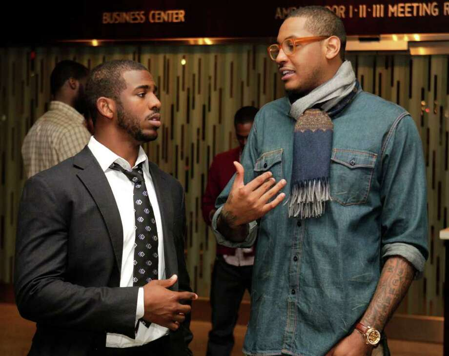 New Orelans Hornets' Chris Paul, left, and New York Knicks' Carmelo Anthony talk after a meeting of the players' union in New York, Monday, Nov. 14, 2011. The NBA players rejected the league's latest offer and have begun the process to disband the union. (AP Photo/Seth Wenig) Photo: Seth Wenig