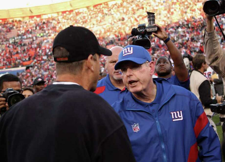 SAN FRANCISCO, CA - NOVEMBER 13:  New York Giants head coach Tom Coughlin shakes hands with San Francisco 49ers head coach Jim Harbaugh after their game at Candlestick Park on November 13, 2011 in San Francisco, California.  (Photo by Ezra Shaw/Getty Images) Photo: Ezra Shaw