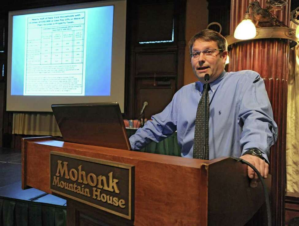Ron Deutsch, New Yorkers for Fiscal Fairness and Omnibus Consortium, speaks at a meeting involving people who oppose the new tax cap at the Mohonk Mountain House in New Paltz, N.Y. Monday, Nov. 14, 2011.(Lori Van Buren / Times Union)