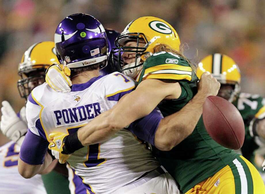 Green Bay Packers outside linebacker Clay Matthews hits Minnesota Vikings quarterback Christian Ponder (7) and causes a fumble during the first half of an NFL football game Monday, Nov. 14, 2011, in Green Bay, Wis. The Vikings recovered the ball. (AP Photo/Mike Roemer) Photo: Mike Roemer