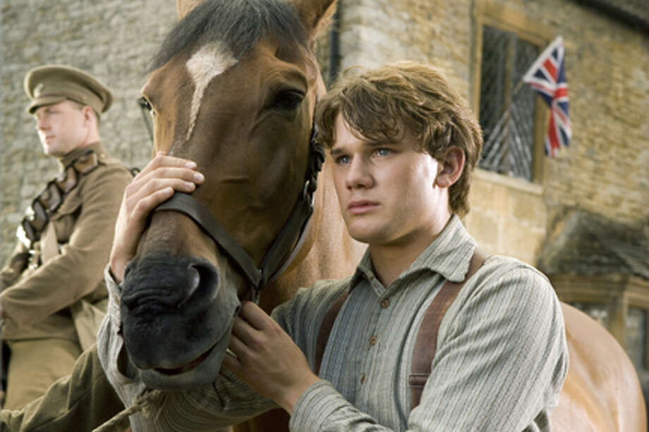 "Joey and Jeremy Irvine as Albert in ""War Horse."" Photo: Andrew Cooper;SMPSP / ©DreamWorks II Distribution Co., LLC.  All Rights Reserved."