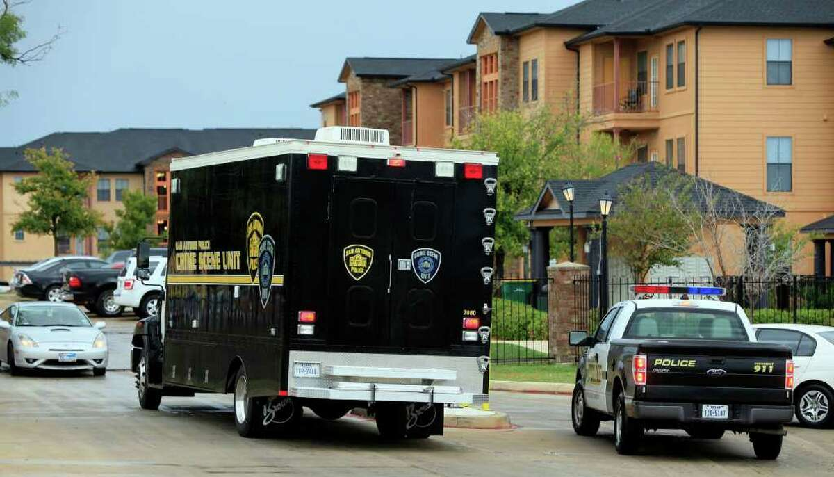 A San Antonio Police Department Crime Scene Unit enters the Hacienda del Sol Luxury Apartment Homes at 6710 Babcock Tuesday November 15, 2011 where a man opened fire with an AK-47 rifle killing another man. A 20-year-old man is in custody for the shooting. JOHN DAVENPORT/jdavenport@express-news.net