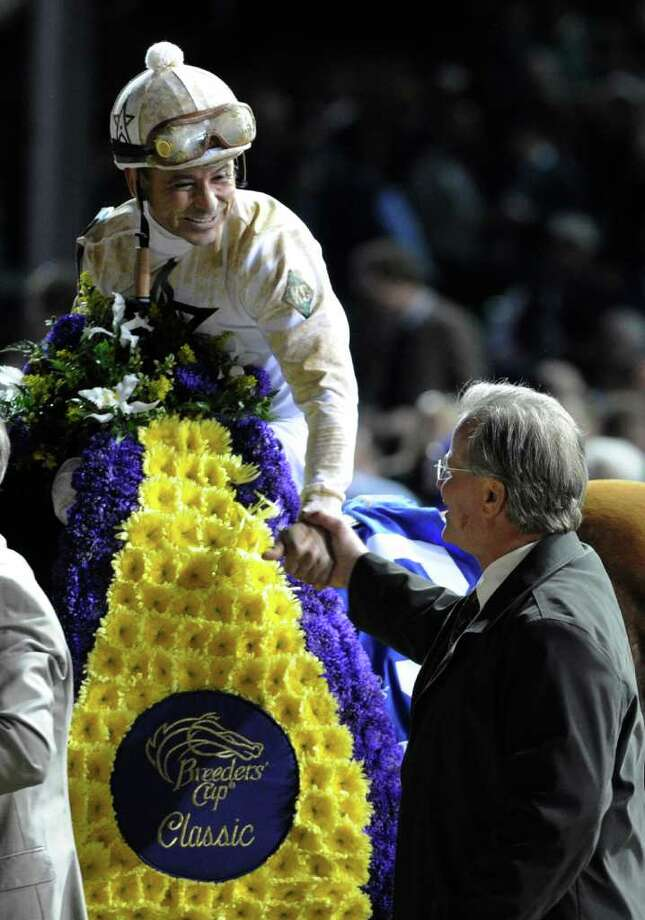 Jockey Mike Smith shakes the hands with trainer Bill Motts after Drosselmeyer won the Breeders' Cup Classic at Churchill Downs in Louisville, K.Y. November 5, 2011.      (Skip Dickstein / Times Union) Photo: SKIP DICKSTEIN