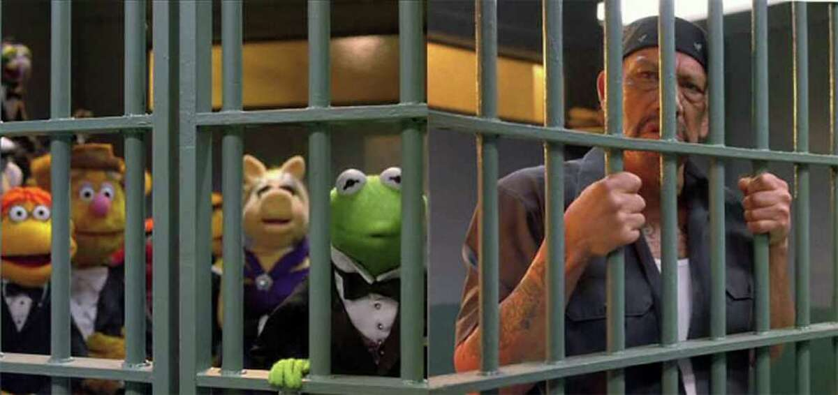 Danny Trejo and the Muppets find themselves behind bars in a scene from