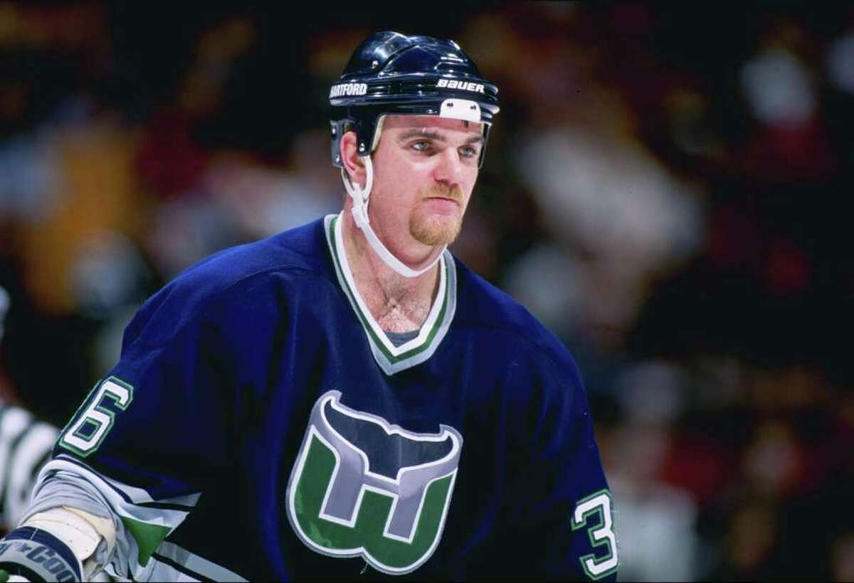 13 Feb 1997: Defenseman Glen Featherstone of the Hartford Whalers looks on during a game against the New Jersey Devils at the Continental Airlines Arena in East Rutherford, New Jersey. The Devils won the game, 4-0. Mandatory Credit: Al Bello /Allsport