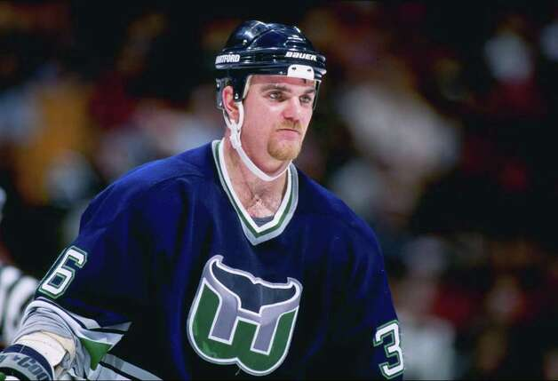 13 Feb 1997:  Defenseman Glen Featherstone of the Hartford Whalers looks on during a game against the New Jersey Devils at the Continental Airlines Arena in East Rutherford, New Jersey.  The Devils won the game, 4-0. Mandatory Credit: Al Bello  /Allsport Photo: File Photo / Stamford Advocate File Photo