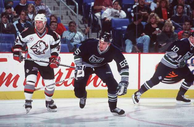 26 Oct 1996:  Keith Primeau #55 of the Hartford Whalers fends off Alexei Zhitnik of the Buffalo Sabres during the Whalers 6-3 loss at the Marine Midland Arena in Buffalo, New York. Mandatory Credit: Rick Stewart/ALLSPORT Photo: File Photo / Stamford Advocate File Photo