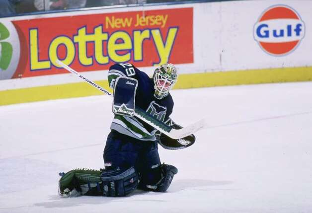 13 Feb 1997:  Goaltender Jason Muzzatti of the Hartford Whalers blocks a shot during a game against the New Jersey Devils at the Continental Airlines Arena in East Rutherford, New Jersey.  The Devils won the game, 4-0. Mandatory Credit: Al Bello  /Allspor Photo: File Photo / Stamford Advocate File Photo