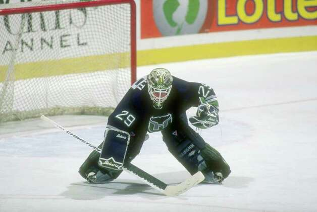 13 Feb 1997:  Goaltender Jason Muzzatti of the Hartford Whalers looks on during a game against the New Jersey Devils at the Continental Airlines Arena in East Rutherford, New Jersey.  The Devils won the game, 4-0. Mandatory Credit: Al Bello  /Allsport Photo: File Photo / Stamford Advocate File Photo
