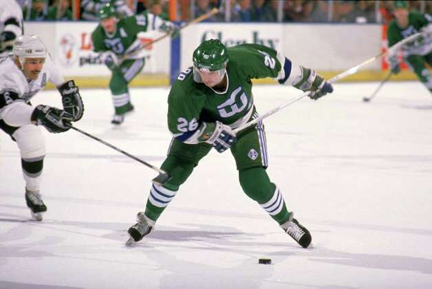 LOS ANGELES - 1989:  Ray Ferraro #20 of the Hartford Whalers takes a shot during a game against the Los Angeles Kings in the 1988-1989 season at the Great Western Forum in Los Angeles, California.  (Photo by Tim DeFrisco/Getty Images) Photo: File Photo / Stamford Advocate File Photo