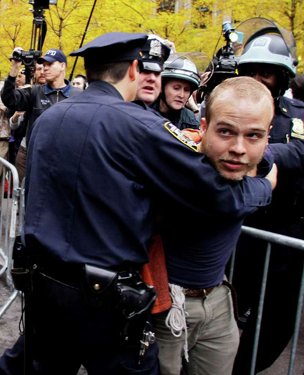 Police arrest an Occupy Wall Street protester at Zuccotti Park on Tuesday, Nov. 15, 2011 in New York. After an early police raid removing protesters, hundreds returned to Zuccotti Park carrying photocopies of a court order they say gives them the right to return there. The National Lawyers Guild obtained a court order allowing the protesters to return with their tents to the park, where they have camped for two months. The guild said the injunction prevents the city from enforcing park rules on the protesters.