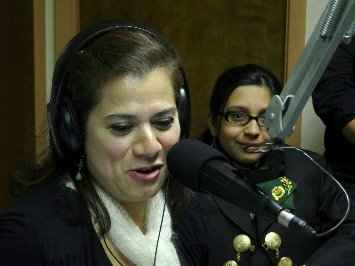 Cynthia Muñoz, left, producer of the annual Mariachi Vargas Extravaganza, is hosting a weekly radio talk and music show on KEDA. She interviews Citlaly Alvarez, a mariachi singer.