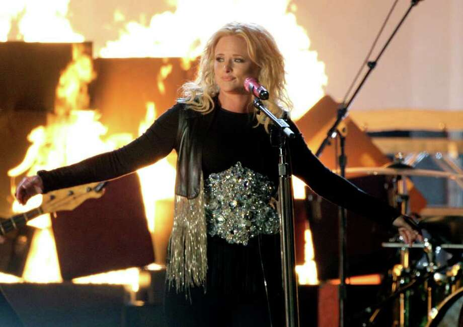 "Miranda Lambert performs new single ""Baggage Claim"" during the CMA Awards. Lambert may flirt with redneck cartoonishness but doesn't let it define her. Photo: MARK HUMPHREY, ASSOCIATED PRESS / AP"
