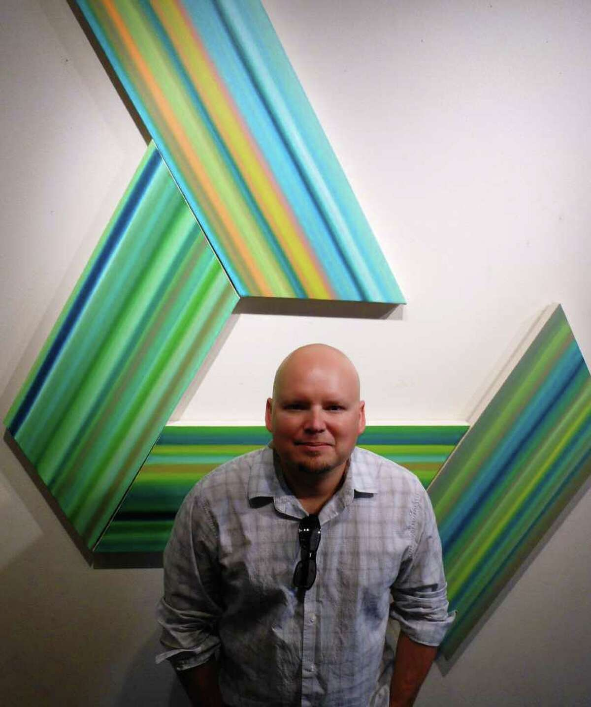San Antonio artist Louis Vega Trevino poses with vectors. Radius Gallery is playing host to Lines & Stripes, an exhibition of Trevino's works.