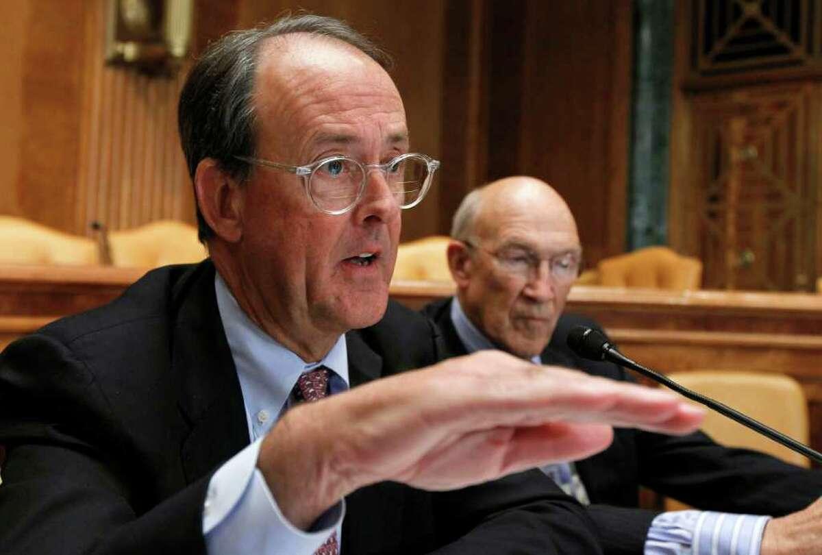 Erskine Bowles, left, accompanied by former Wyoming Sen. Alan Simpson, co-chairmen of President Barack Obama's bipartisan deficit commission, speaks on Capitol Hill on Nov. 10, 2010.