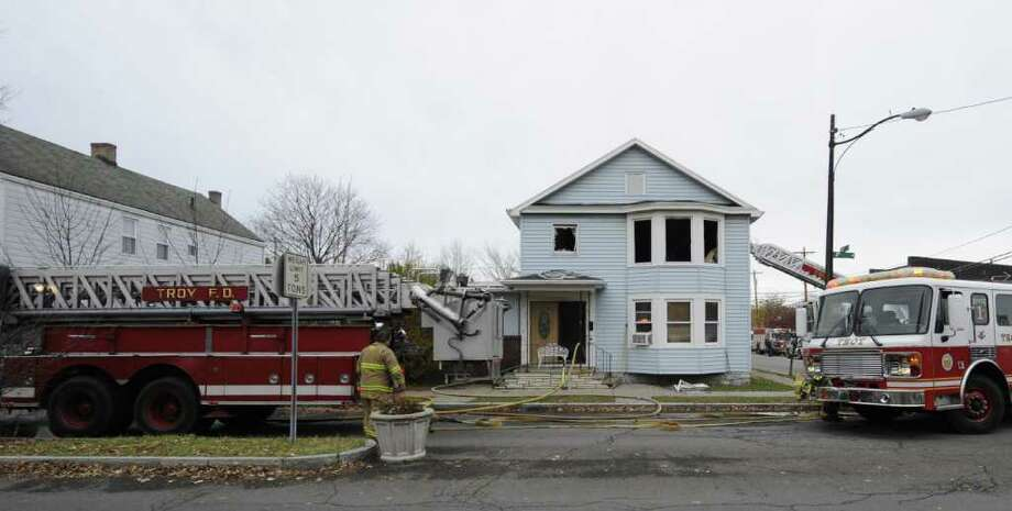 A two-alarm fire hit a home on the corner of 112th Street and 6th Avenue in Troy, N.Y.  November 15, 2011.  (Skip Dickstein/Times Union) Photo: Skip Dickstein