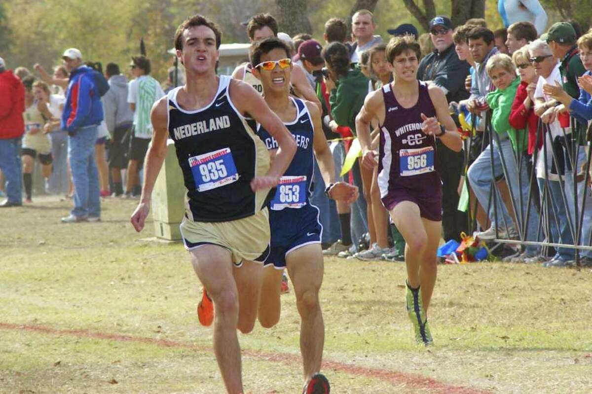 Boerne Champions' Stephen Tankerlsey (853) looks to pass Nederland's Layne Smith (935) and Whitehouse's Troy Hayden near the end of last Saturday's Class 4A, UIL state championships at Round Rock. Tankersley paced the Chargers to their third state title in the past four years.