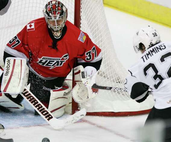 San Antonio Rampage's Scott Timmins, right, takes a shot on Abbotsford Heat goaltender Leland Irving during the second period of an AHL hockey game, Tuesday, Nov. 15, 2011, in San Antonio. Photo: Darren Abate, Darren Abate/pressphotointl.com / Darren Abate/pressphotointl.com