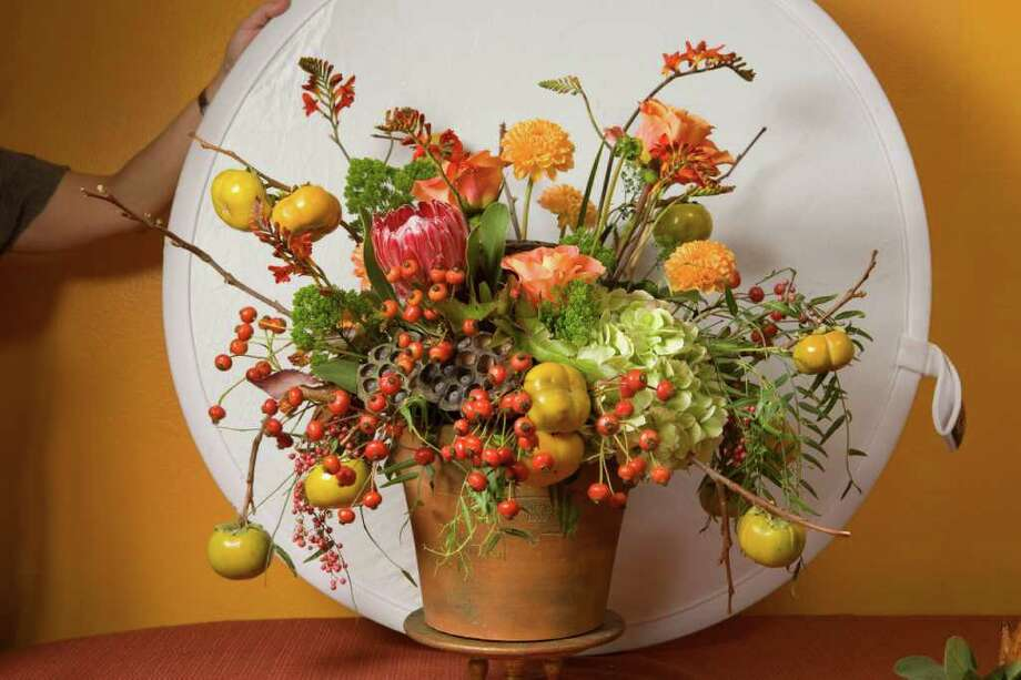 FILE PHOTO  for a fine bouquet: Buy fresh flowers the day before your Thanksgiving dinner. Photo: Kevin Fujii / Houston Chronicle