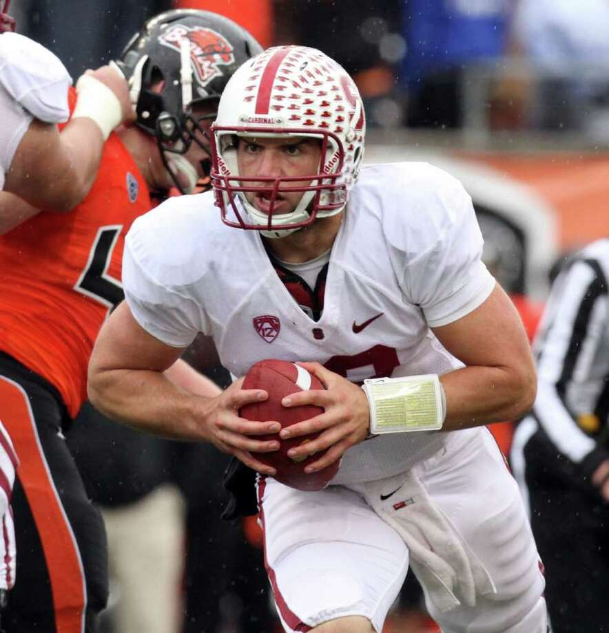Stanford quarterback Andrew Luck rushes for yardage during the second half of an NCAA college football game against Oregon State in Corvallis, Ore.,  Saturday, Nov. 5, 2011.  Luck threw for 206 yards, rushed for 28 yards and threw three touchdown passes in their 38-13 win. Photo: AP