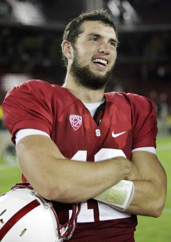 ADVANCE FOR WEEKEND EDITIONS, OCT. 22-23 - FILE - In this Oct. 8, 2011 file photo, Stanford quarterback Andrew Luck (12) smiles on the sidelines late in the fourth quarter against Colorado, in Stanford, Calif. For fans of NFL teams that are already out of the playoff hunt, about the only thing left to cheer for is more failure and a shot at drafting Luck. Photo: AP