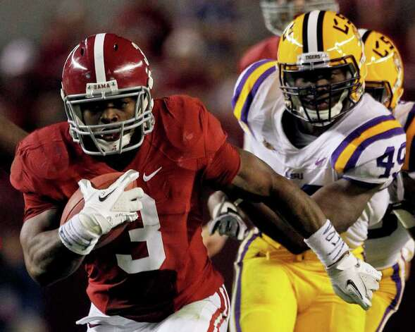 Alabama running back Trent Richardson (3) runs upfield as LSU defensive end Barkevious Mingo (49) defends during the first half of an NCAA college football game Saturday, Nov. 5, 2011, in Tuscaloosa, Ala. Photo: AP