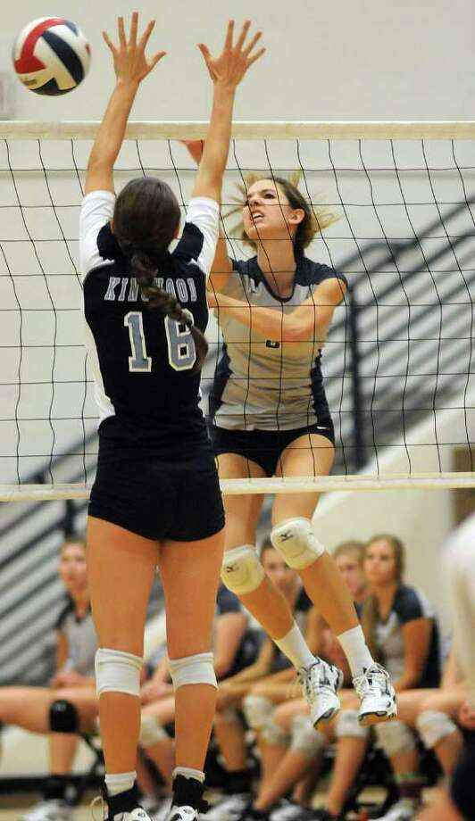 College Park freshman outside hitter Emily Thorson, right, goes for a kill against Kingwood senior Kathryn Copeland. Freelance photo by Jerry Baker Photo: Jerry Baker
