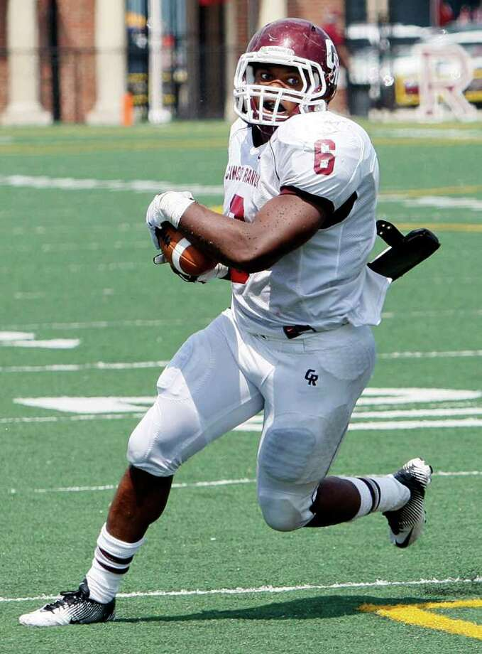 BOB LEVEY: FOR THE CHRONICLE BREAKING FREE: Cinco Ranch running back Jamel James rushed for 253 yards and two touchdowns in a playoff win over Bellaire. Photo: Bob Levey / ©2011 Bob Levey