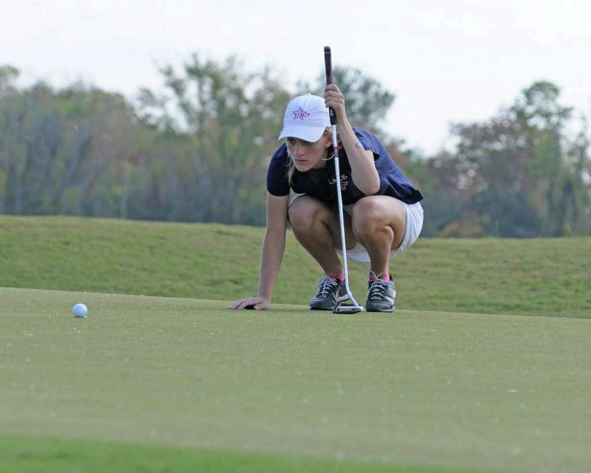 L. SCOTT HAINLINE: FOR THE CHRONICLE CONCENTRATION: Clear Lake senior Bristol Gunderson lines up a putt during a team victory at the Clear Springs Tournament recently at Magnolia Creek.