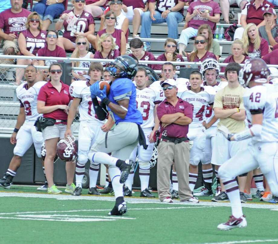 Clear Springs senior wide reciever Marcus Johnson hauls in an 80-yard touchdown reception much to the chagrin of the Cinco Ranch sideline. Cinco Ranch defeated Clear Springs 38-33 on Sept. 10, 2011 at Clear Creek ISD Veterans Memorial Stadium in League City. Photo: L. Scott Hainline / freelance
