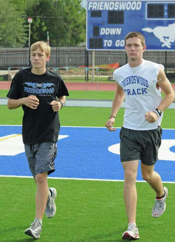 Friendswood 2011 juniors Levi Kessler, left, and Ryan Teel are 2-for-2 when it comes to state meets having advanced with the Friendswood team as freshmen in 2009, and as individuals last year (2010). Pictured here during a 2011 summer workout at Henry Winston Stadium at Friendswood High School. Photo: L. Scott Hainline / freelance
